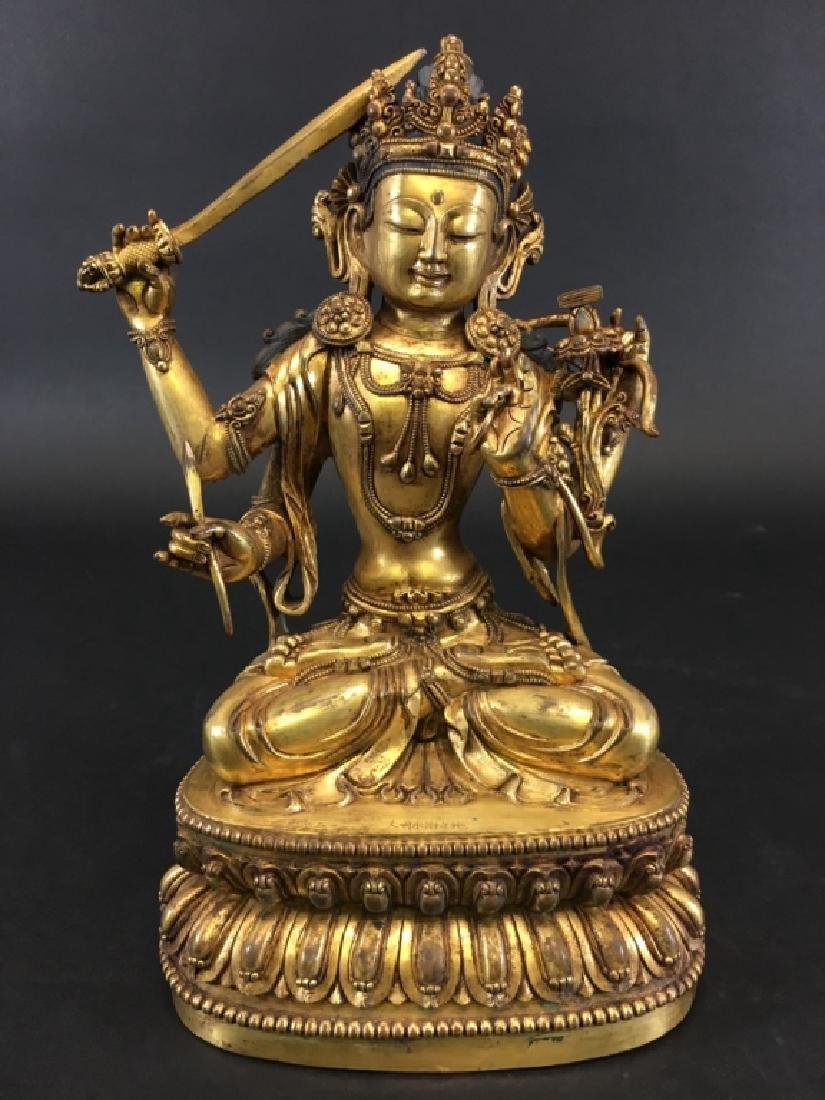 YONGLE MARK, A GILT BUDDHA FIGURE