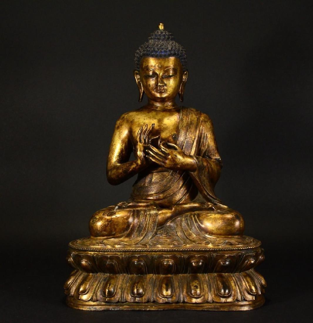 A BRONZE GILT BUDDHA