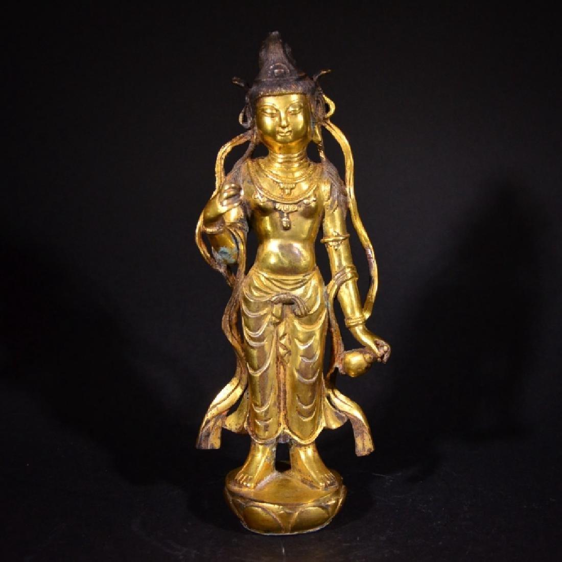 A GILD BRONZE BUDDHA