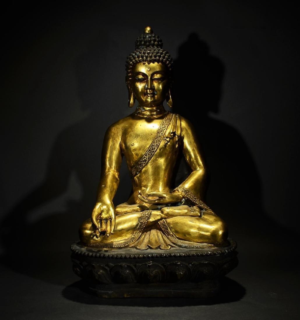 YONGLE MARK, A GILT BRONZE BUDDHA FIGURE OF SAKYAMUNI