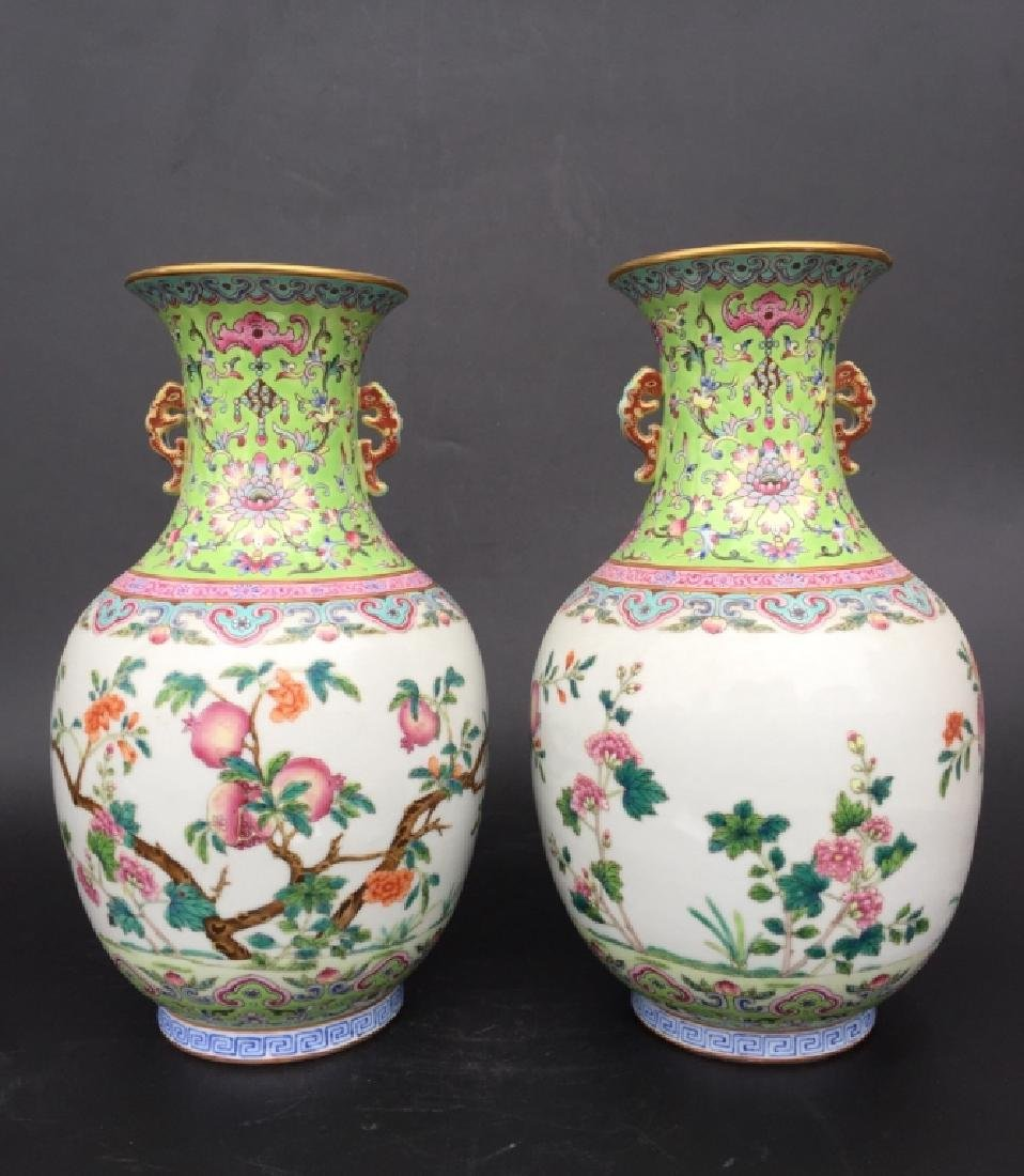 PAIR OF GREEN GROUND FAMILLE ROSE VASES