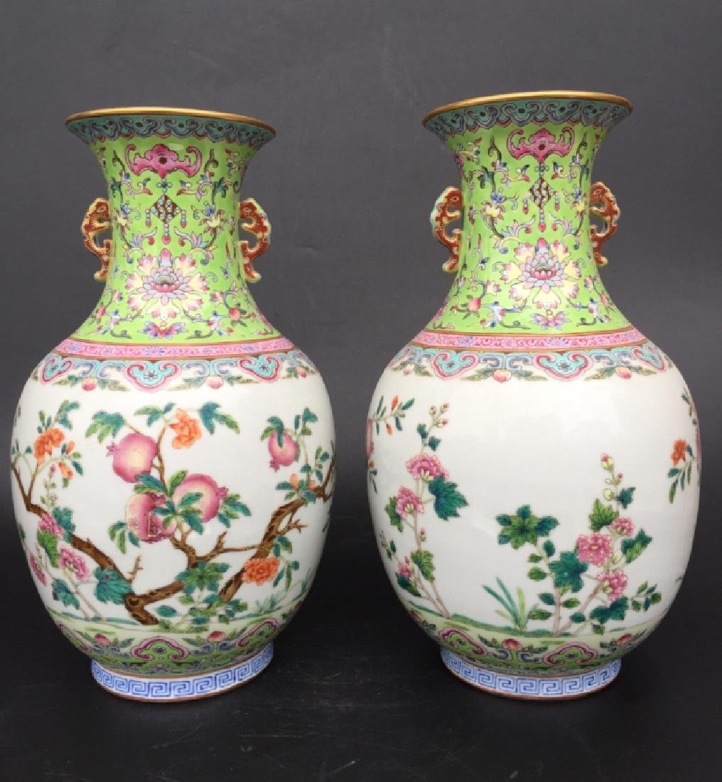 PAIR OF GREEN GROUND FAMILLE ROSE VASES - 2