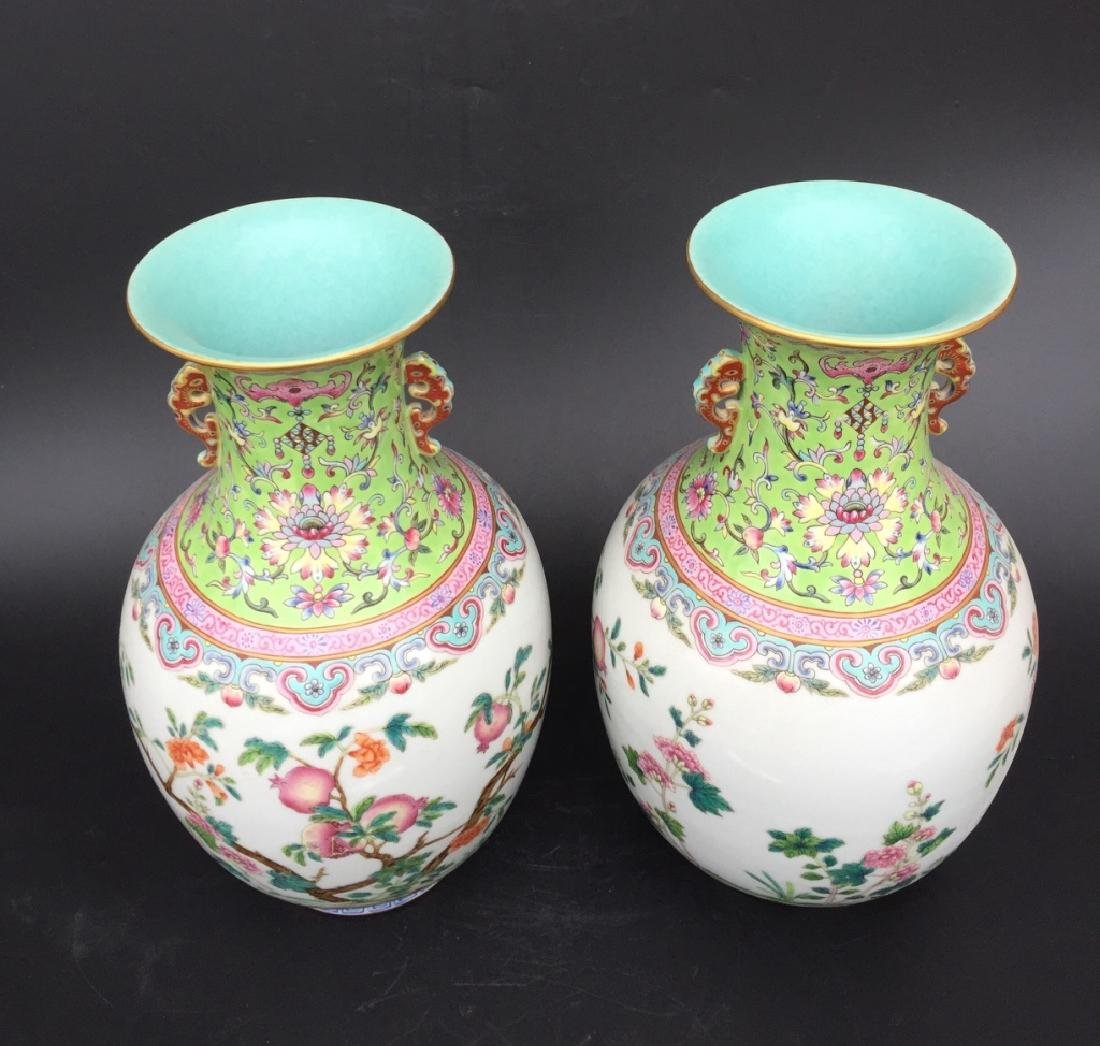 PAIR OF GREEN GROUND FAMILLE ROSE VASES - 3