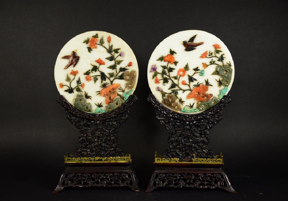 A PAIR OF WHITE GLASS PLAQUE