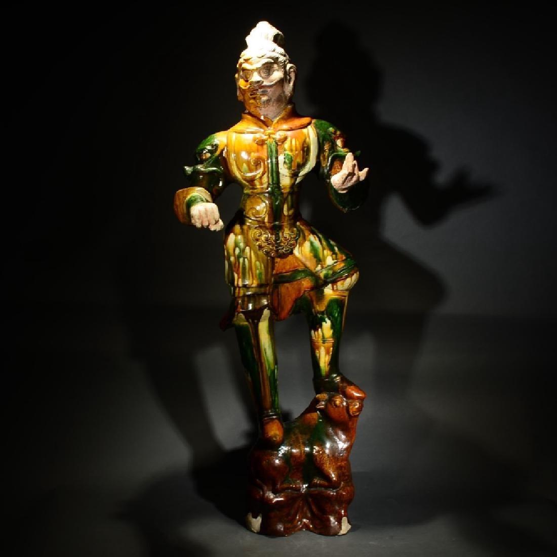 A TANG SAN CAI FIGURE OF A GUARDIAN KING