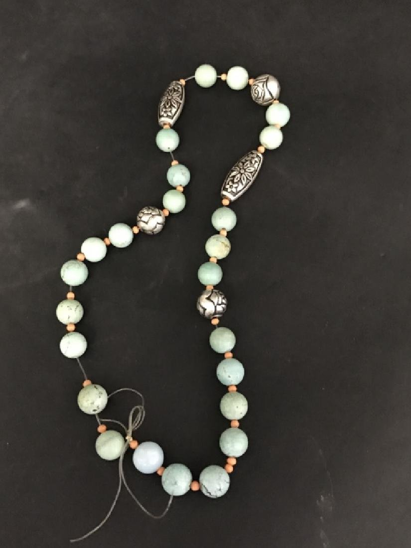 A TURQUOISE WITH SILVER NECKLANCE