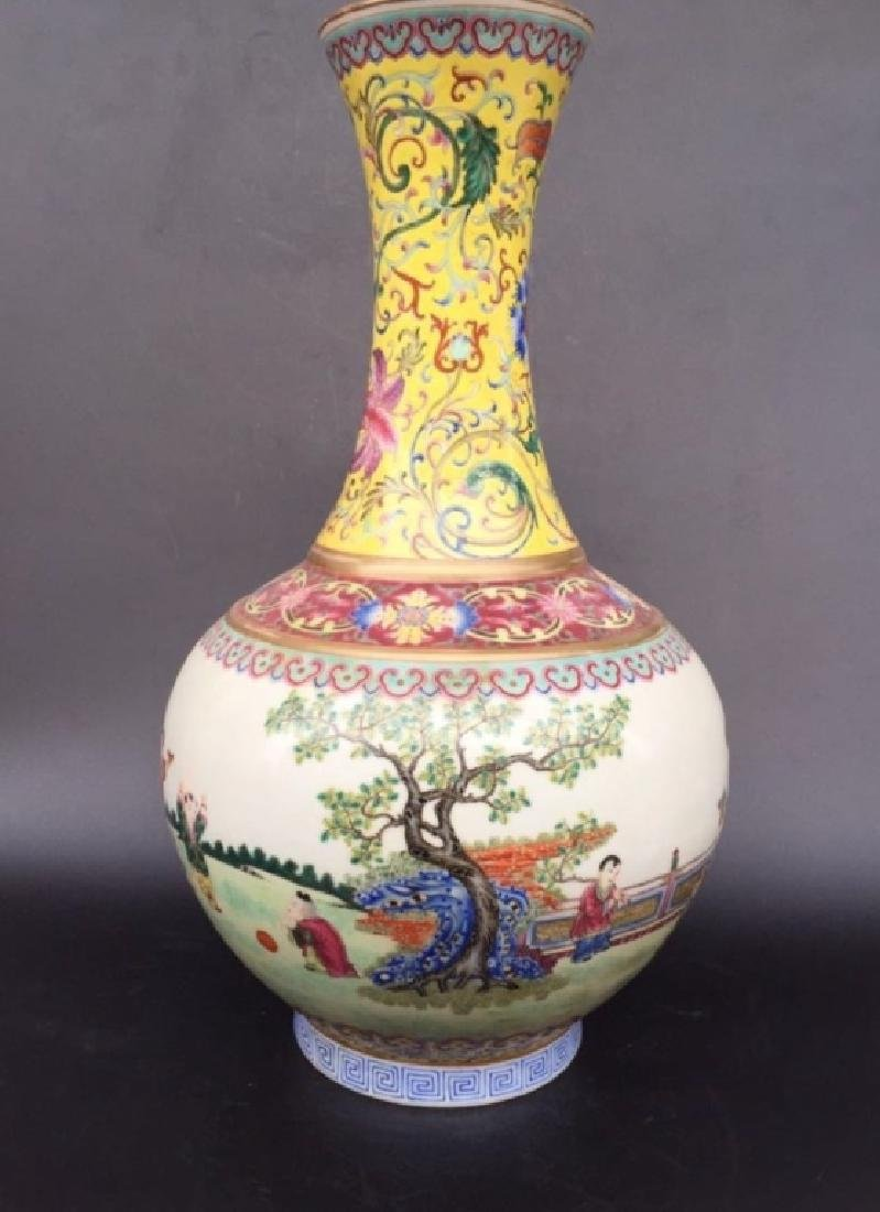 JIAQING MARK,QING D.,A YELLOW GROUND FAMILLE ROSE VASE