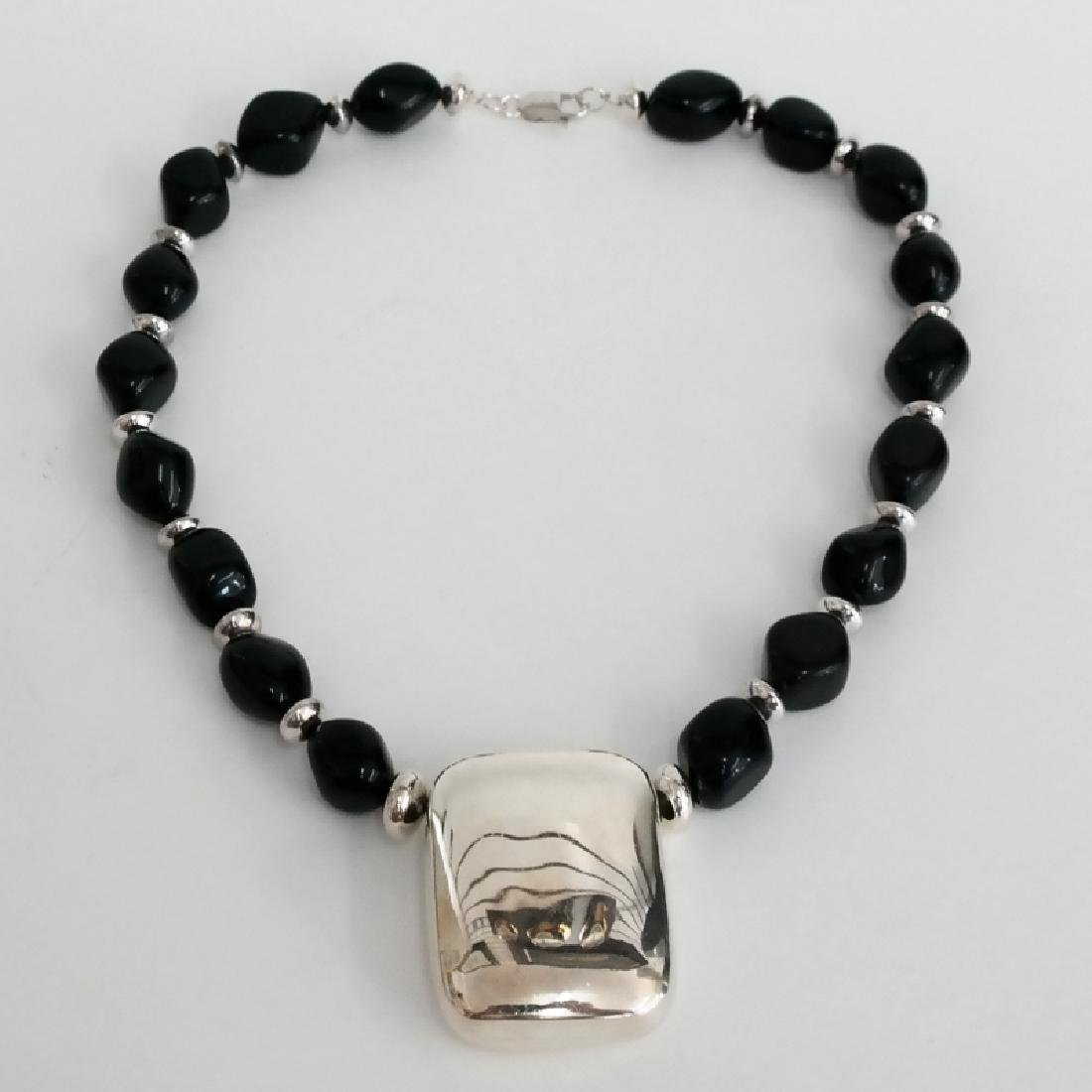 Black onyx free shape beads and sterling silver hollow