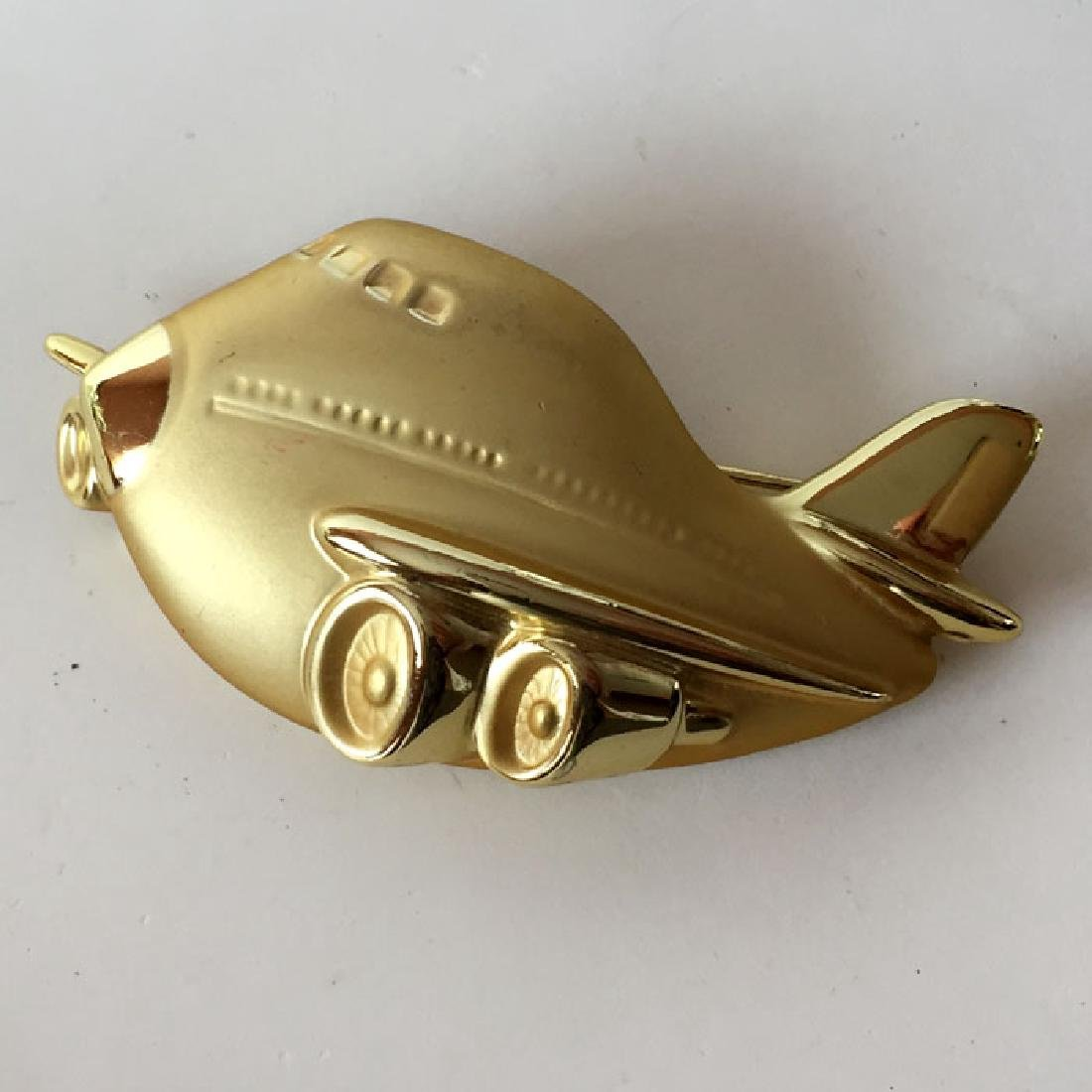 A.J.C.: Gold plated satin and shiny finish PLANE shaped