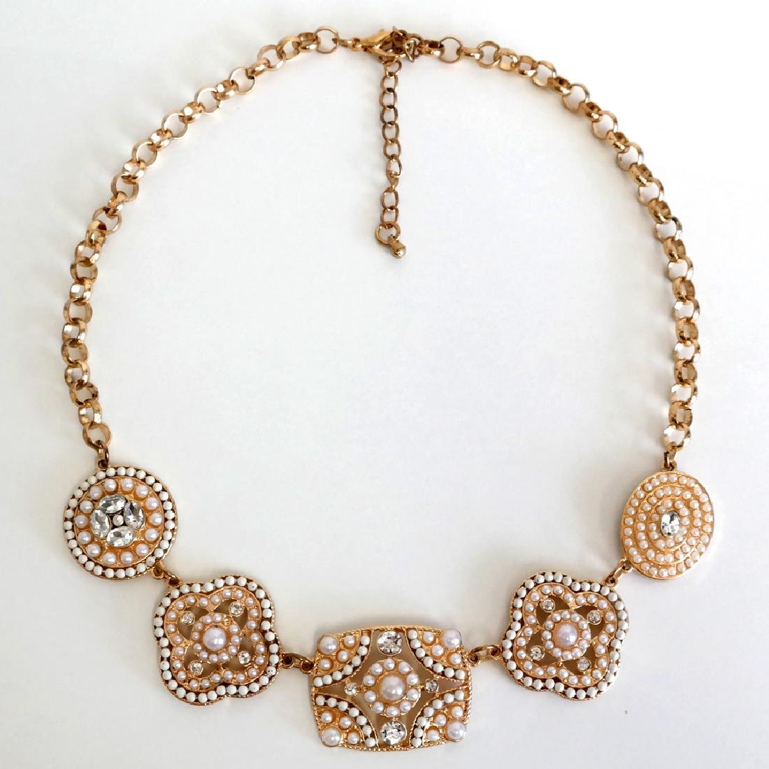 Gold tone necklace with white rhinestones and white