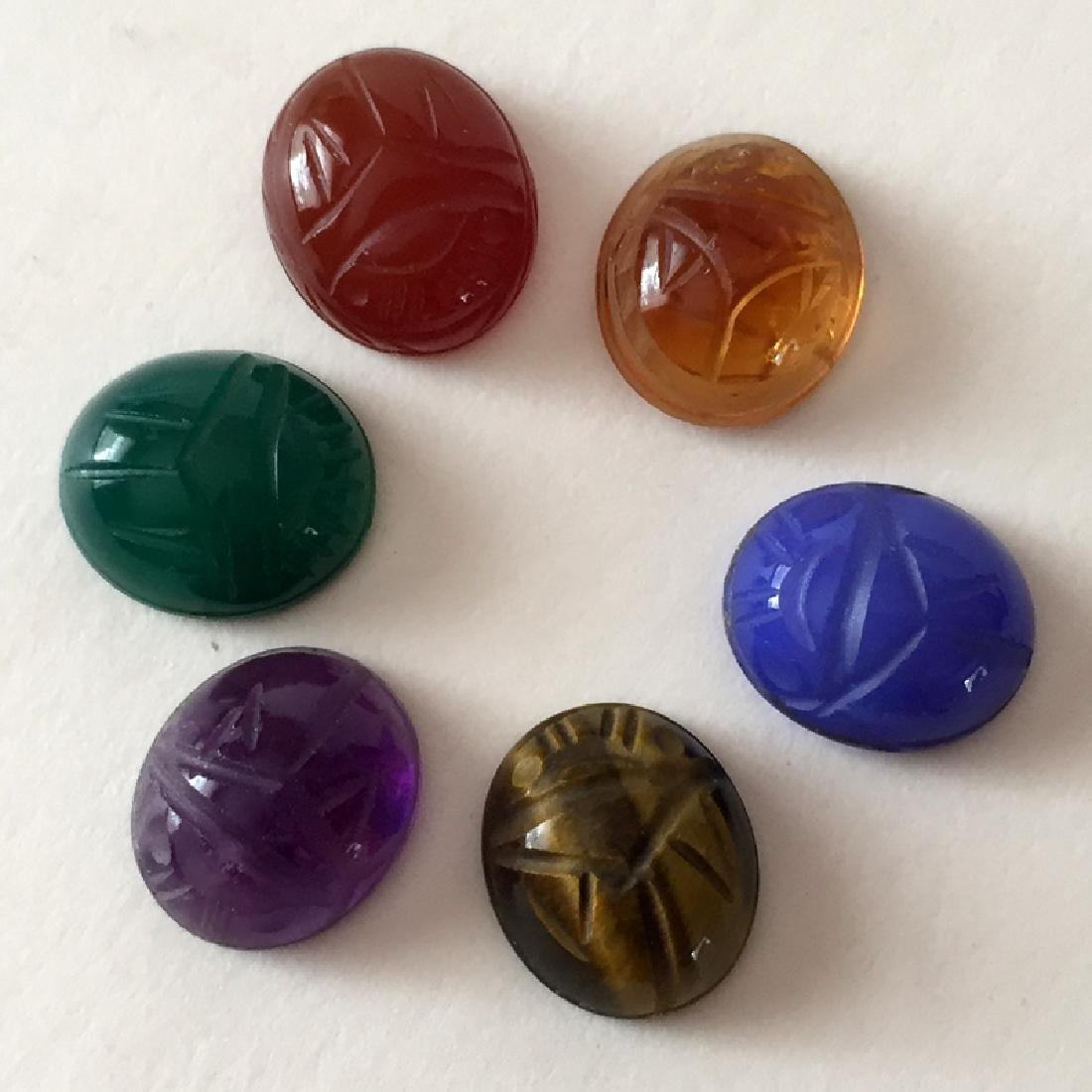 Lot of 6 carved genuine stone oval cabochons