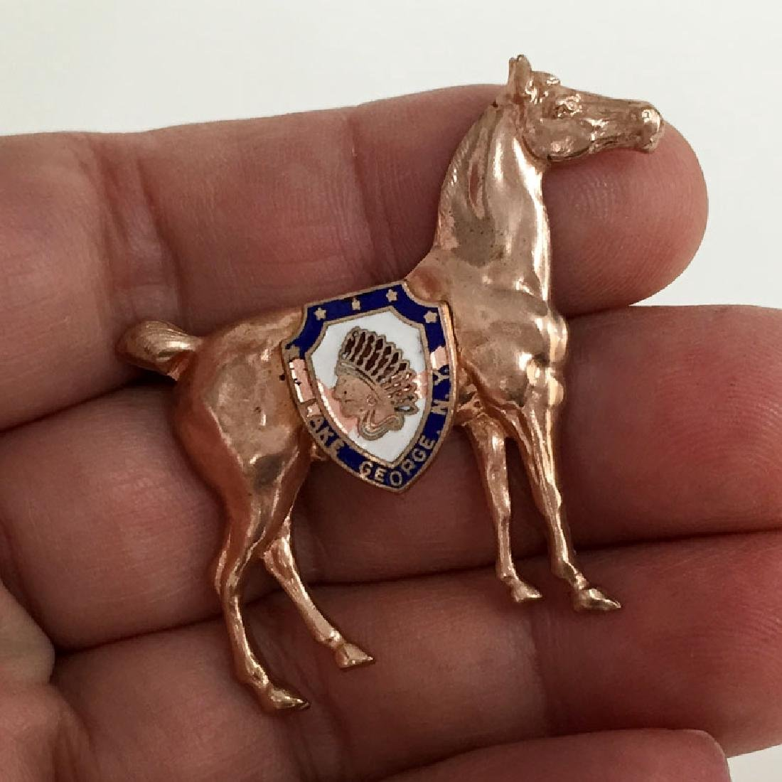 Vintage pink color metal HORSE shaped brooch with