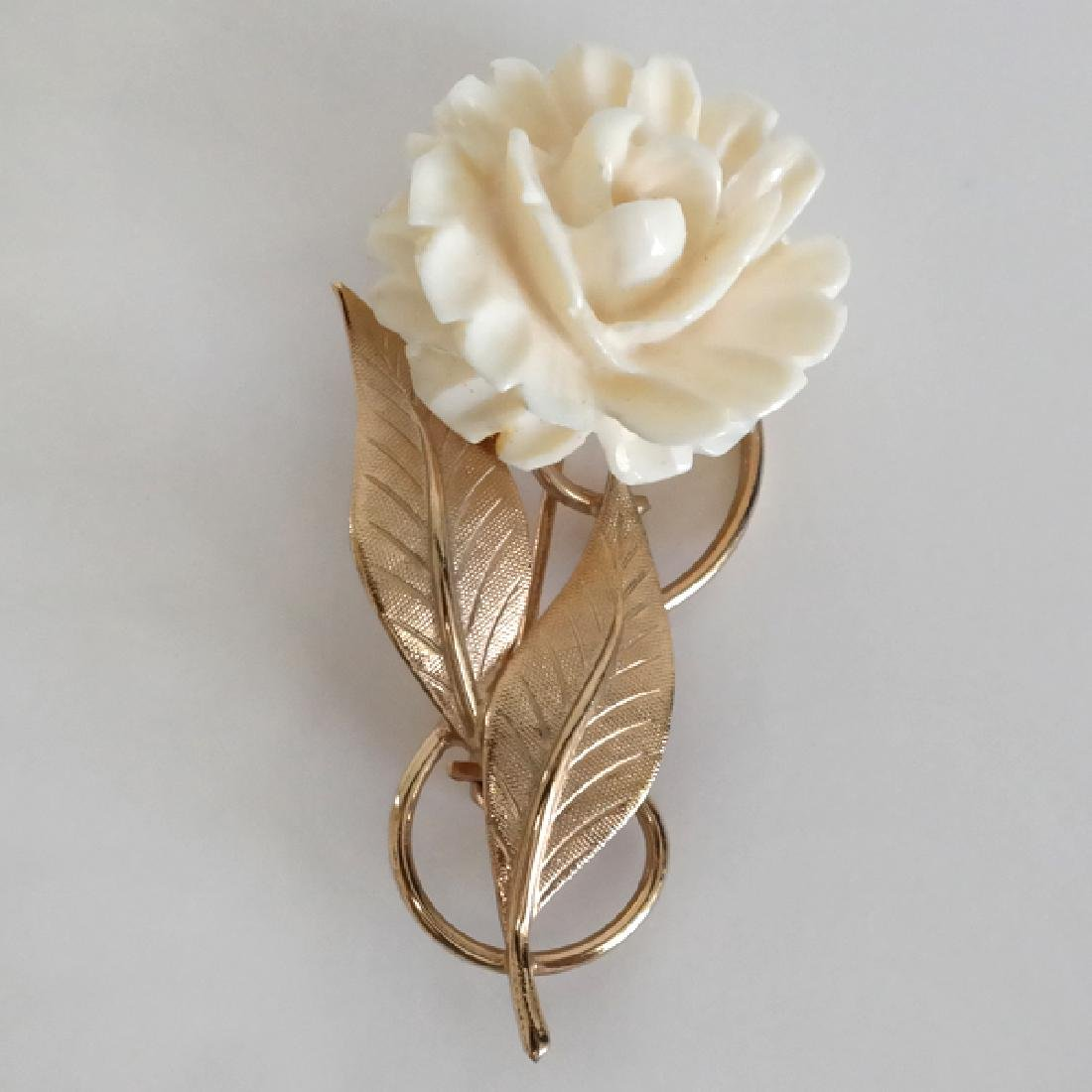 Gold plated textured leaves with carved angel skin