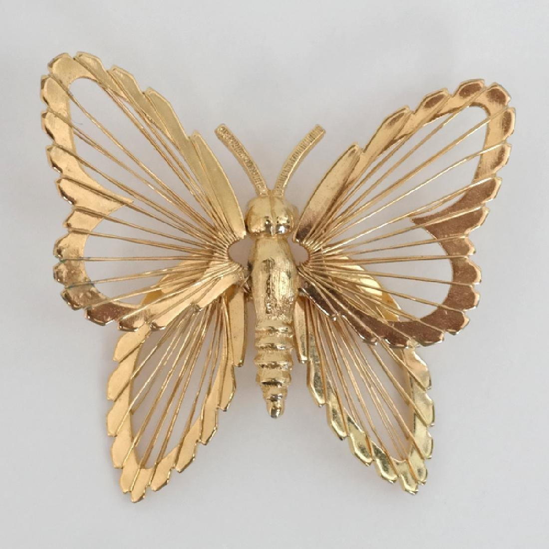 Gold tone butterfly brooch pin