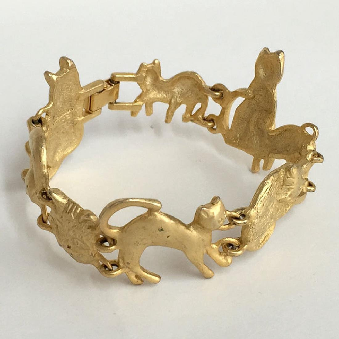 A.J.C.: Gold plated satin finish CATS shaped links