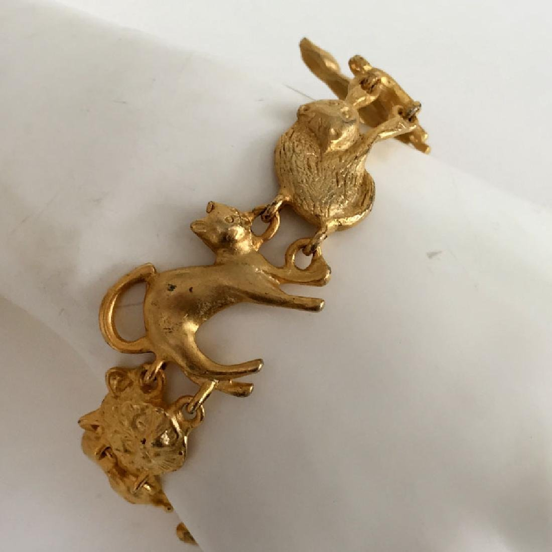 A.J.C.: Gold plated satin finish CATS shaped links - 3