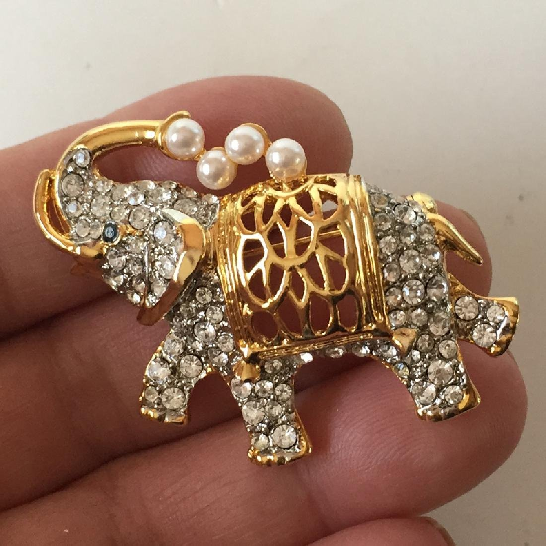Gold plated ELEPHANT shaped brooch with white