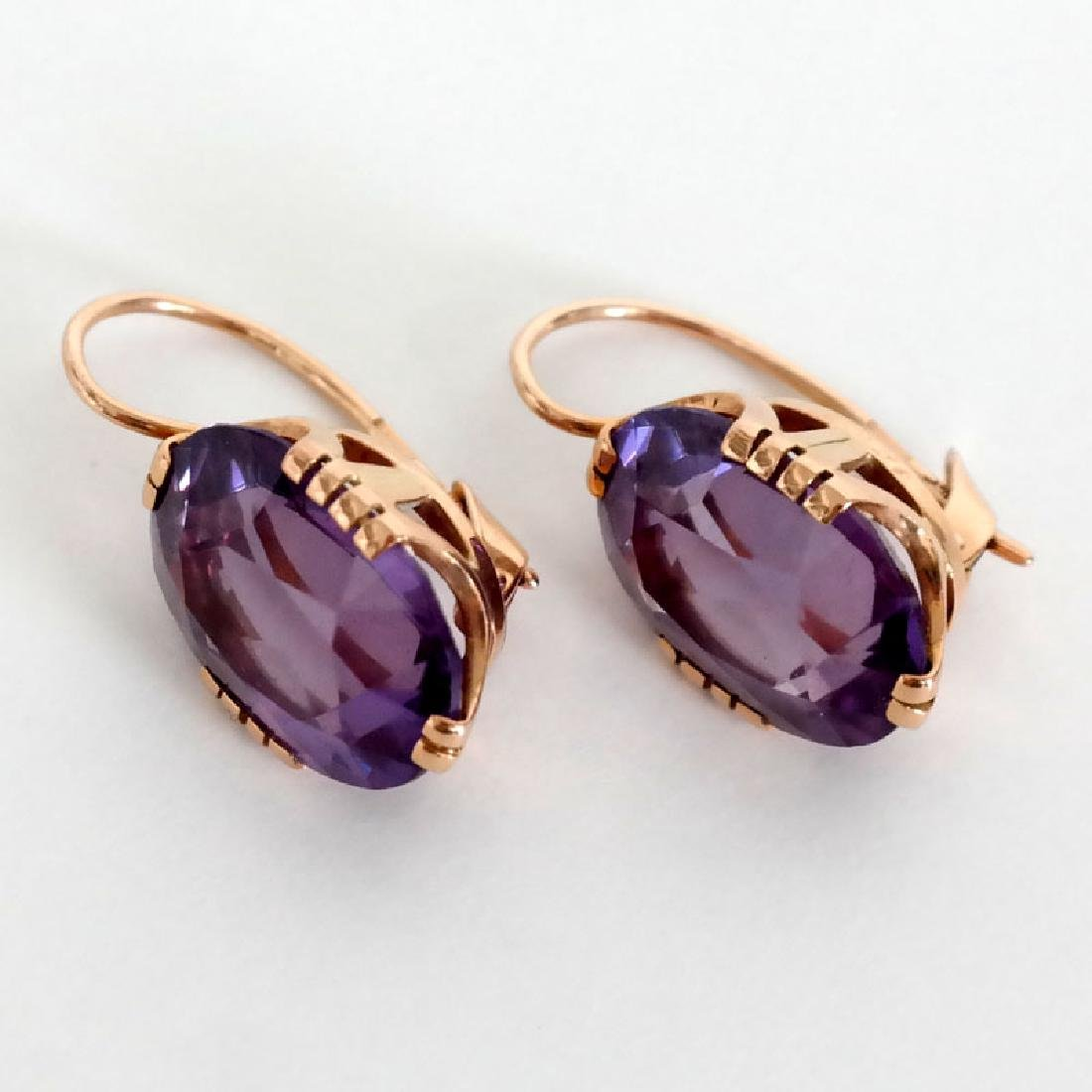 14k pink gold earrings with oval faceted amethysts and