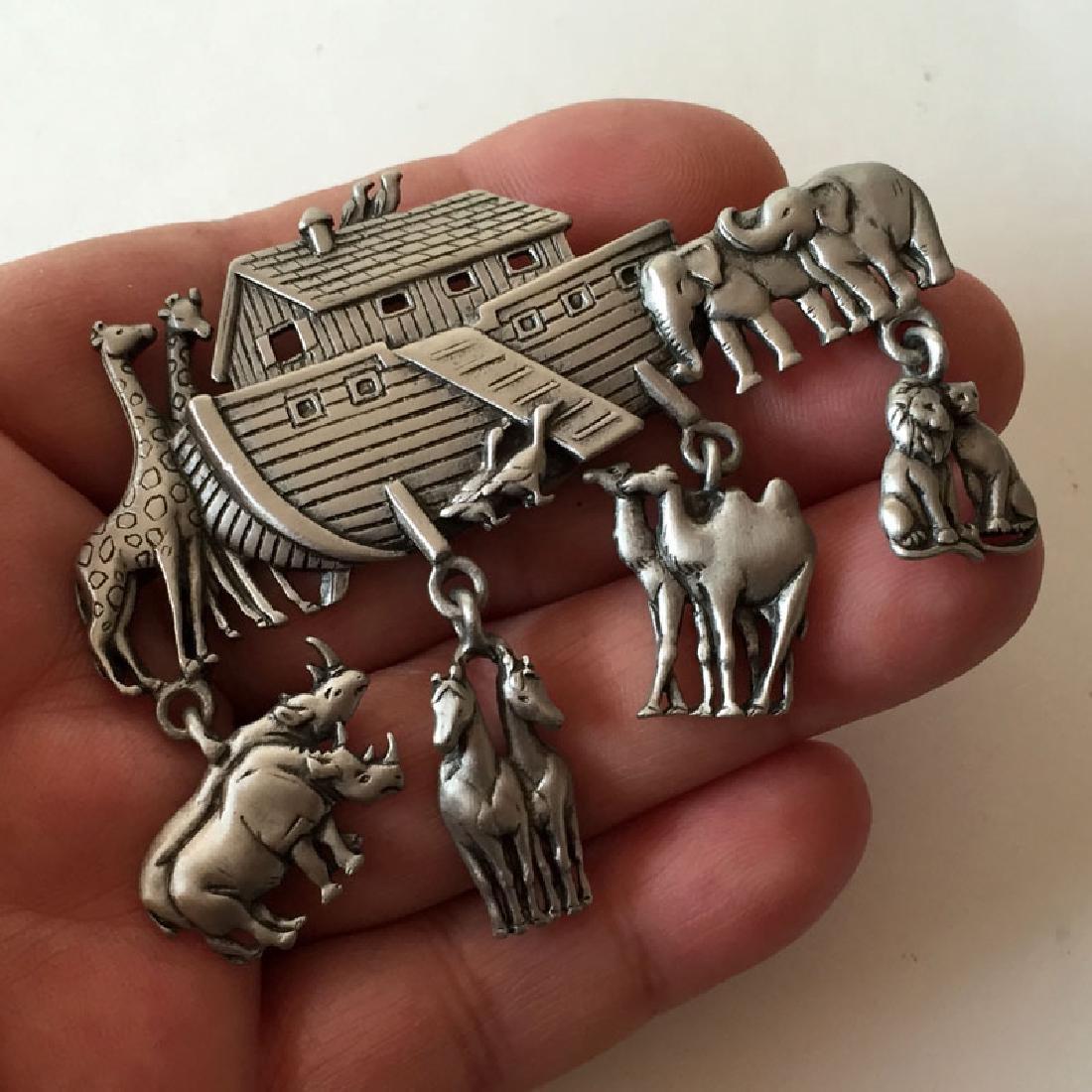 J.J.: Silver tone satin finish NOEV KOVCHEG brooch with