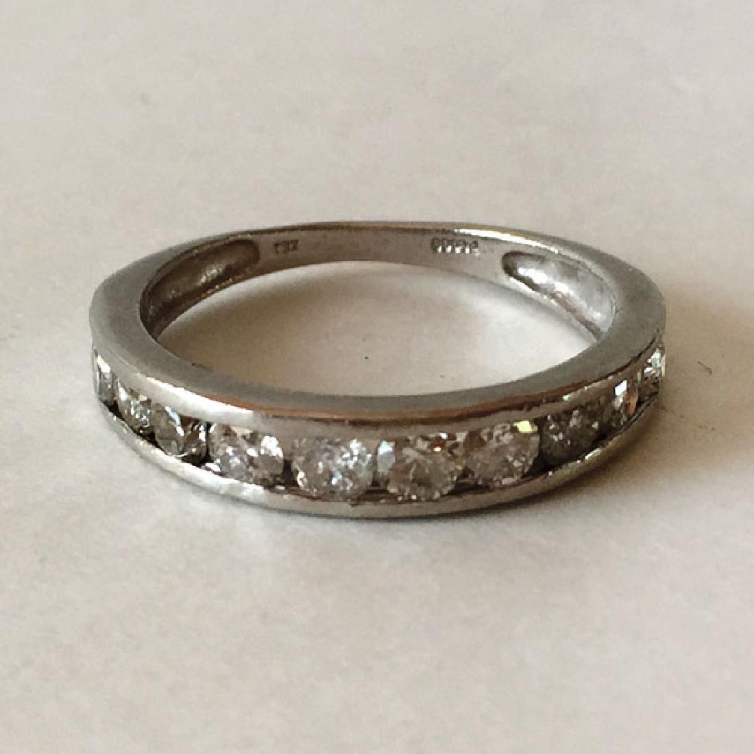 "Platinum diamond ring, size 7 1/4"", signed ZEI."