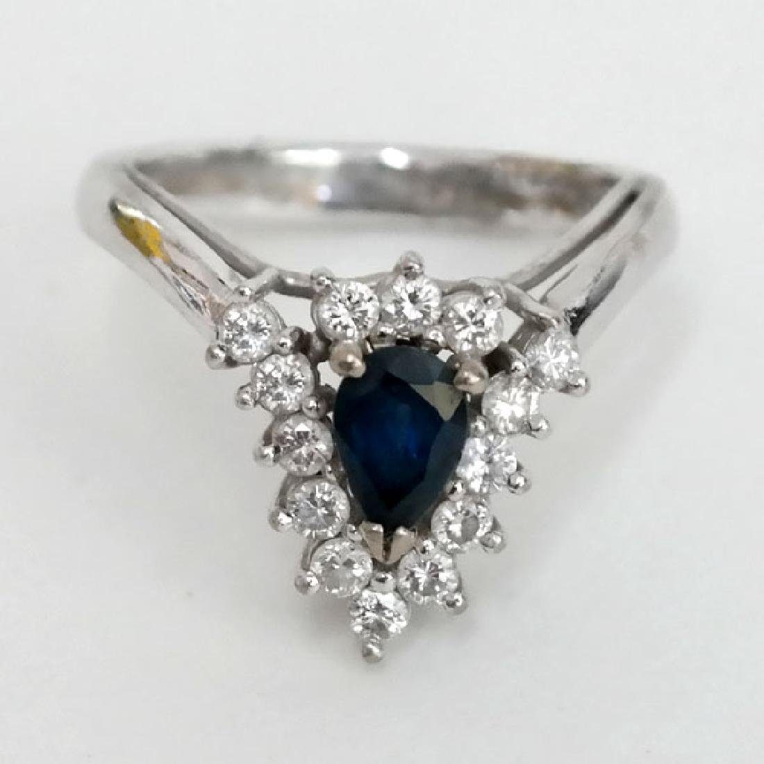 14k white gold genuine sapphires and diamond ring. Size