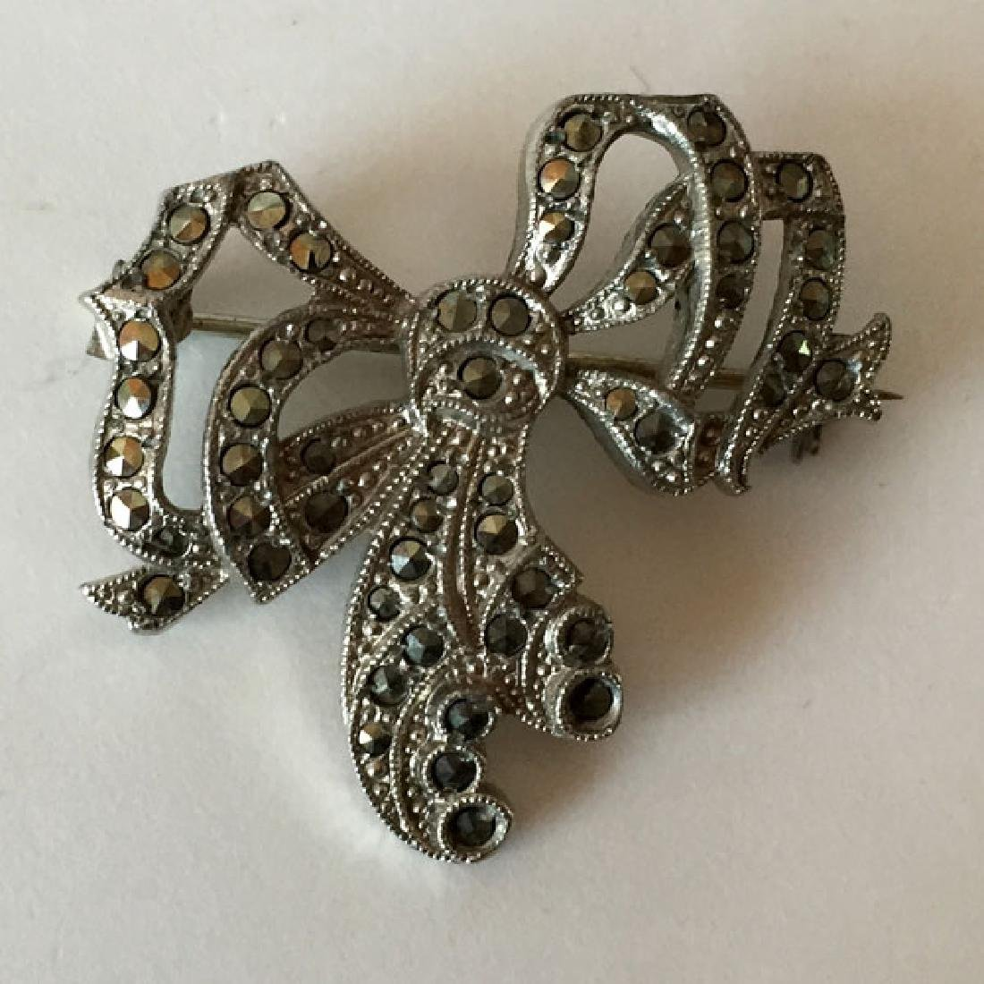 Silver tone antique finish BOW shaped brooch with