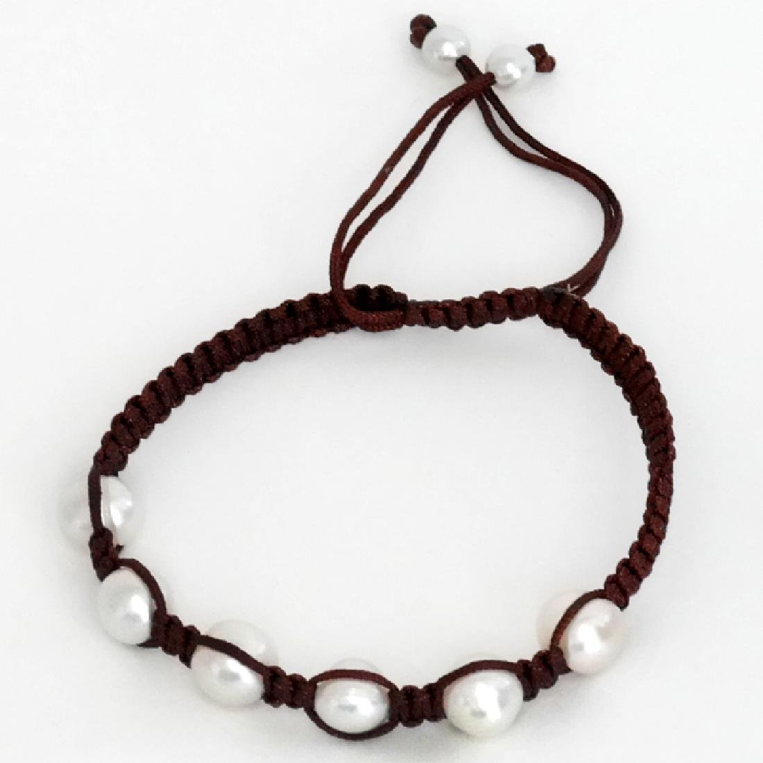 Genuine white 9 mm pearls with bordo color rope