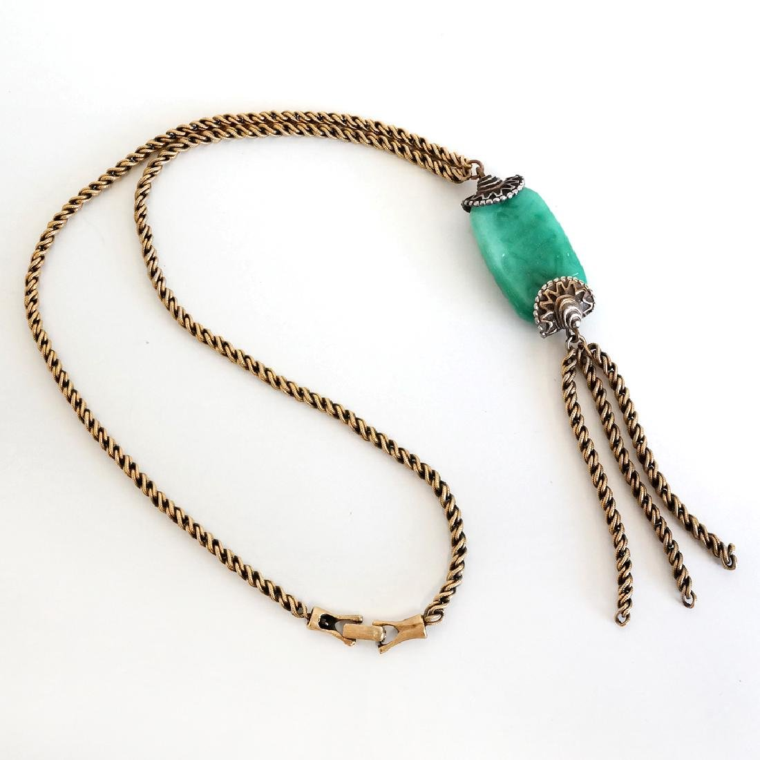 Antique color twisted chain with carved green Jade