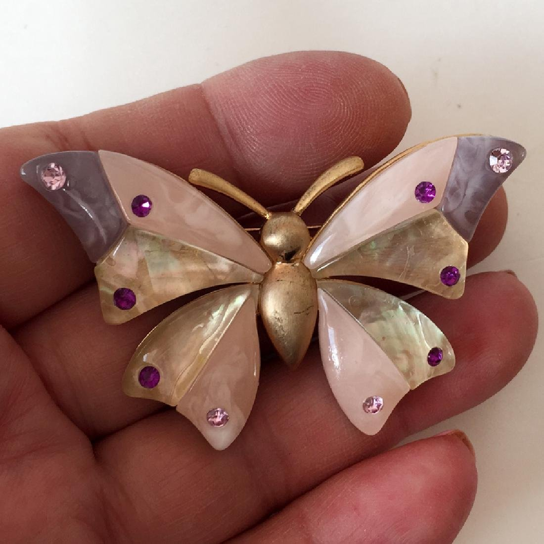 LIZ CLAIBORNE: Gold plated BUTTERFLY shaped brooch with