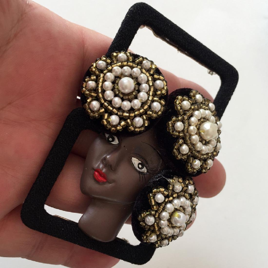 African -American woman face brooch in hat embellished