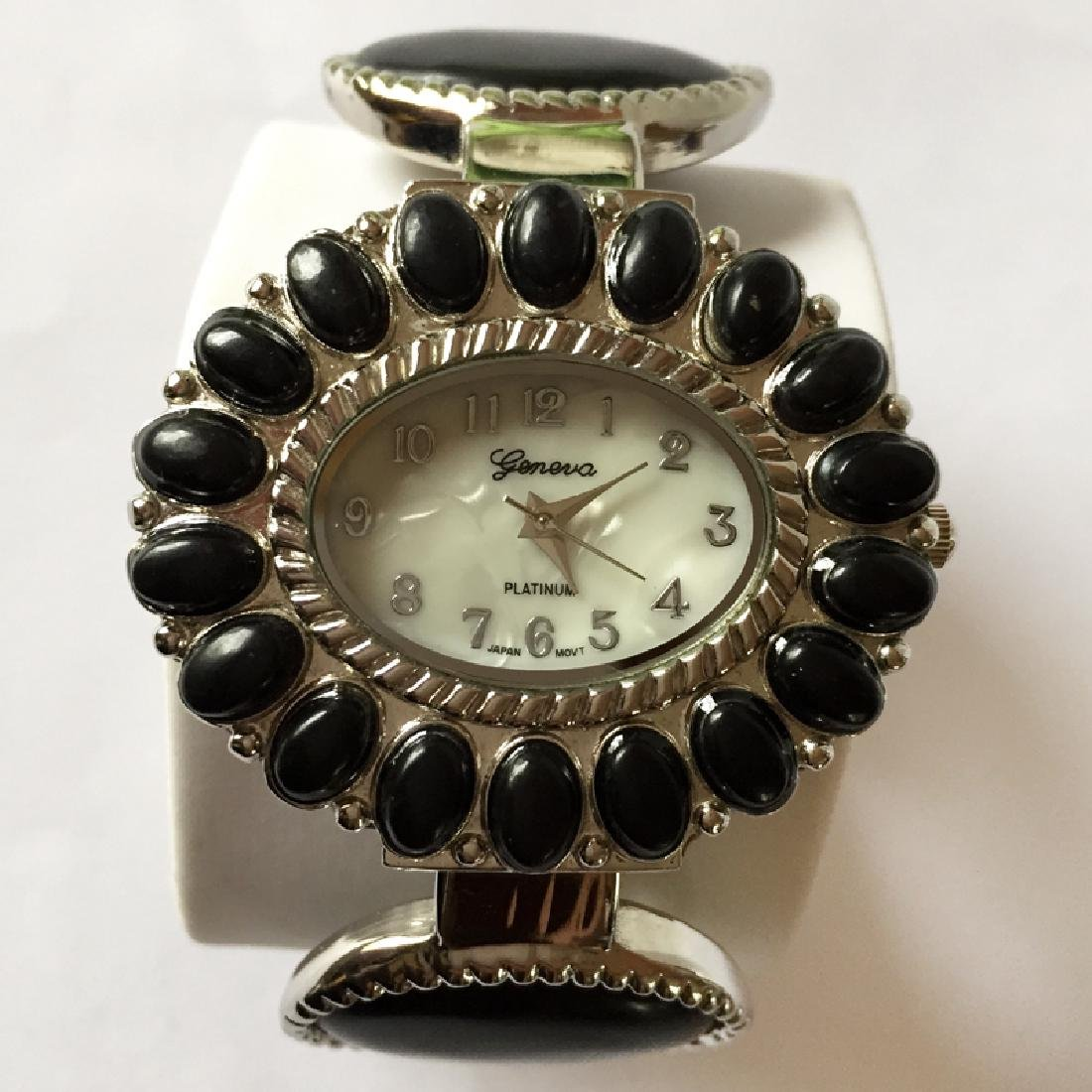 Cuff style bracelet with oval shape watch with MOP dial - 2