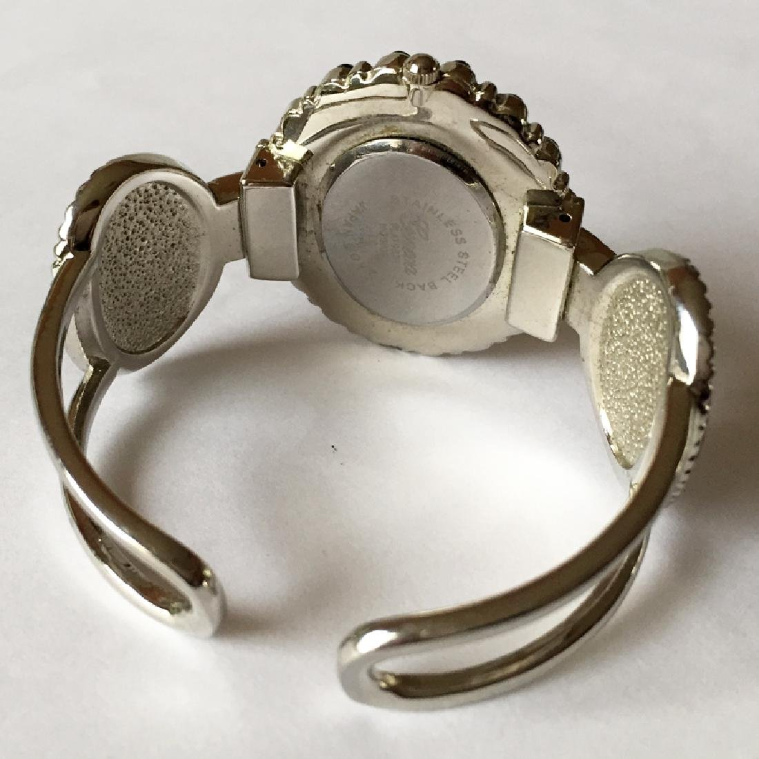 Cuff style bracelet with oval shape watch with MOP dial - 5