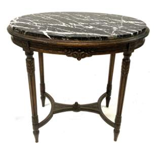 Colby's Antique Marble-Top Oval Table.