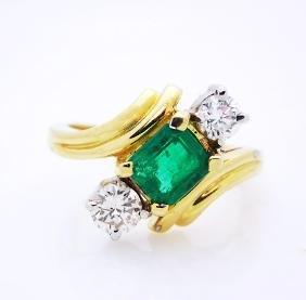 18K Yellow gold Emerald and Diamond ring.
