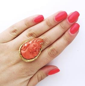 14k gold and carved face coral ring.