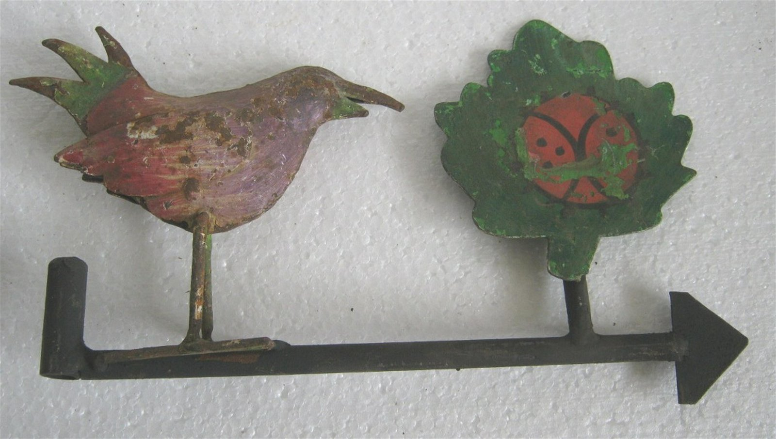 Iron bird and tree weather vane