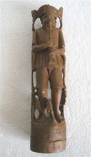 Wooden tribal man wooden figure , fine details .