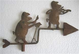 Iron musician pigs weather vane