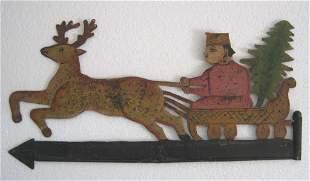 Man on deersledge with christmas tree weather vane