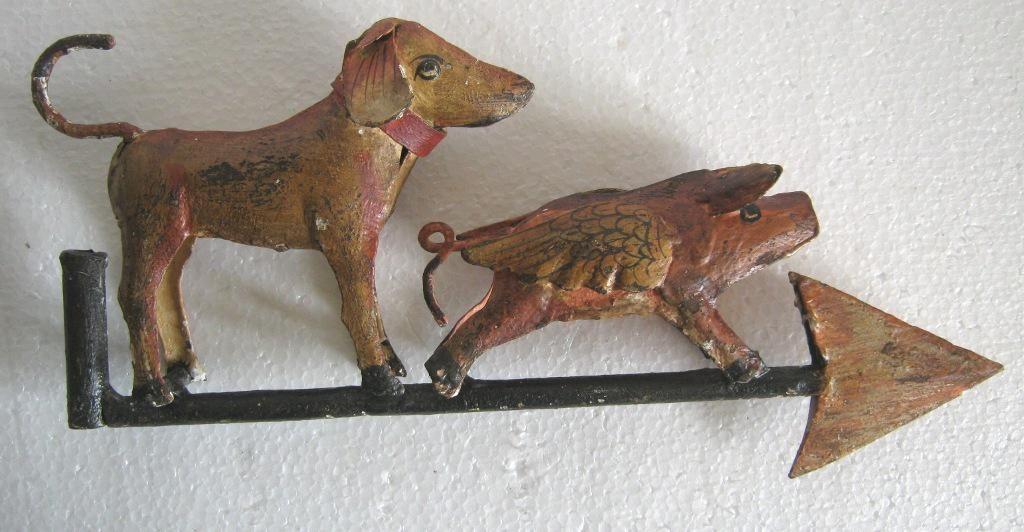 Iron dog and pig weather vane .