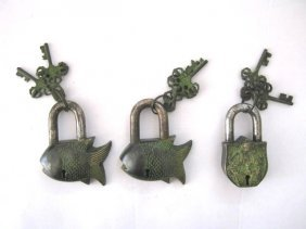 BRASS LOCKS , SET OF THREE . NEPAL