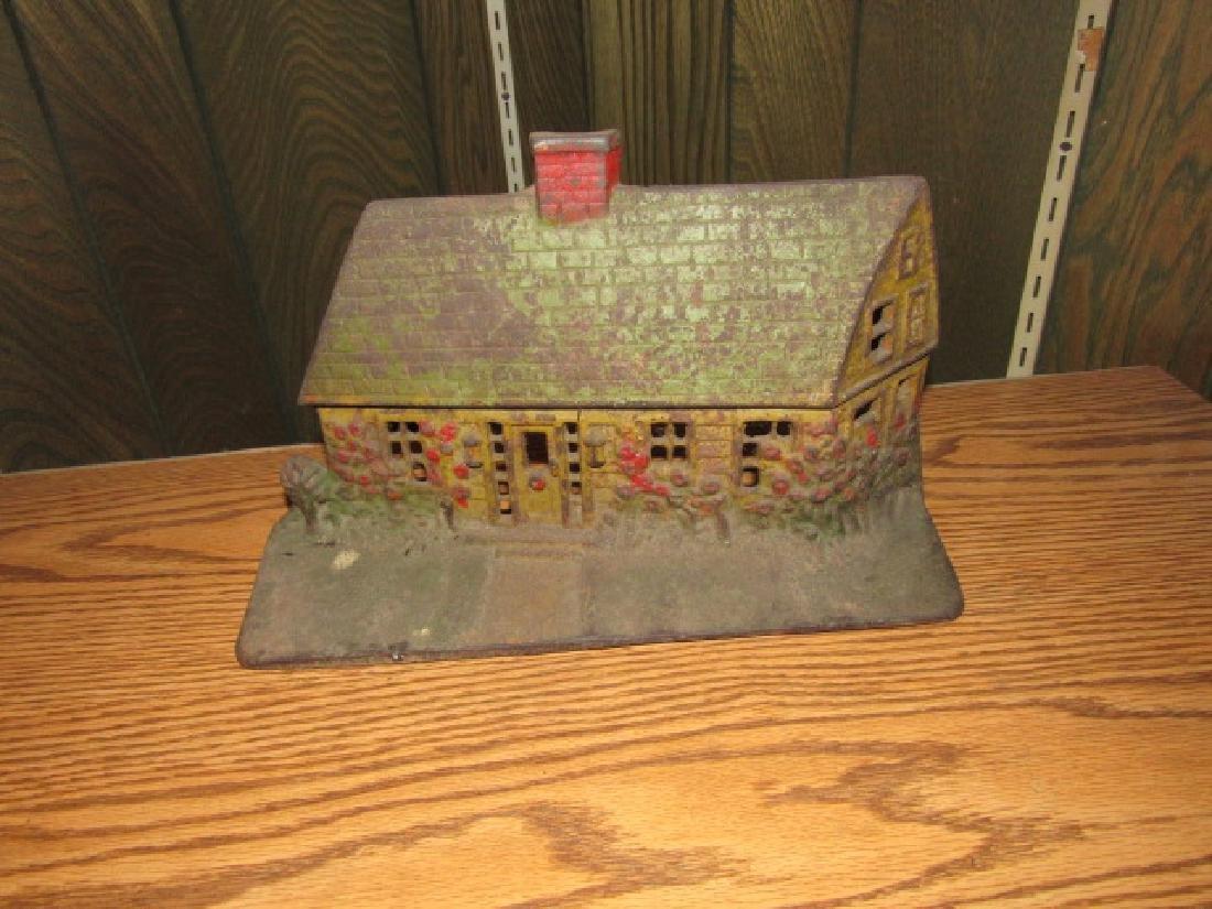 Antique Cast Iron House Doorstop.