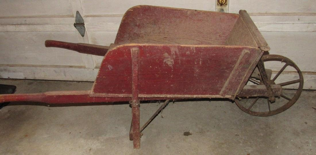 Red Painted Wooden Wheel Barrow
