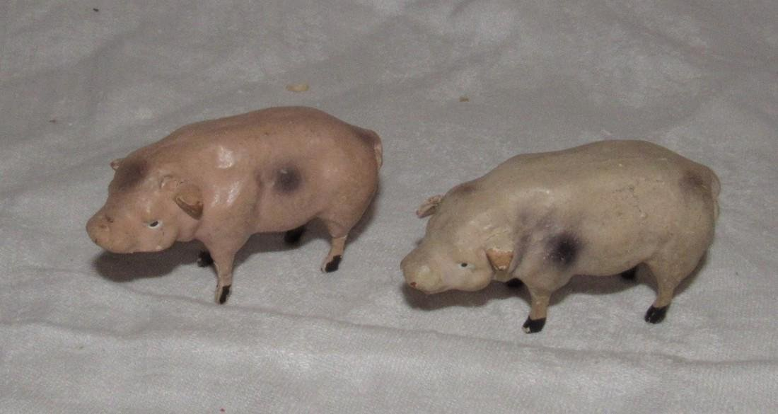 2 Wooden Pigs