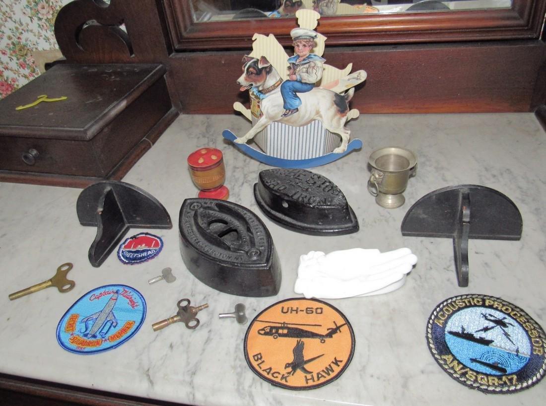 Sad Irons Shelves Military Patches Clock Keys