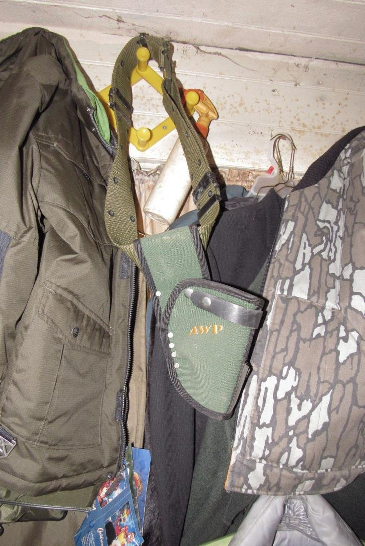 Clothing Life Jackets Gun Holster in front room - 6