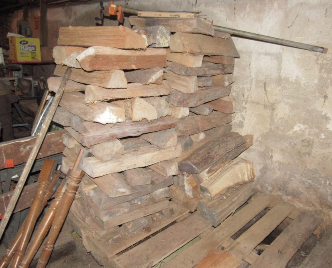 Stacks of Cut & Split Firewood w/ Pipe Clamp