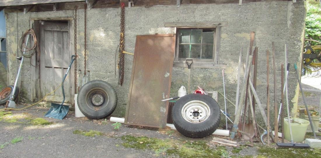 Outside Garage Wall Contents Log Rollers Scrap Iron
