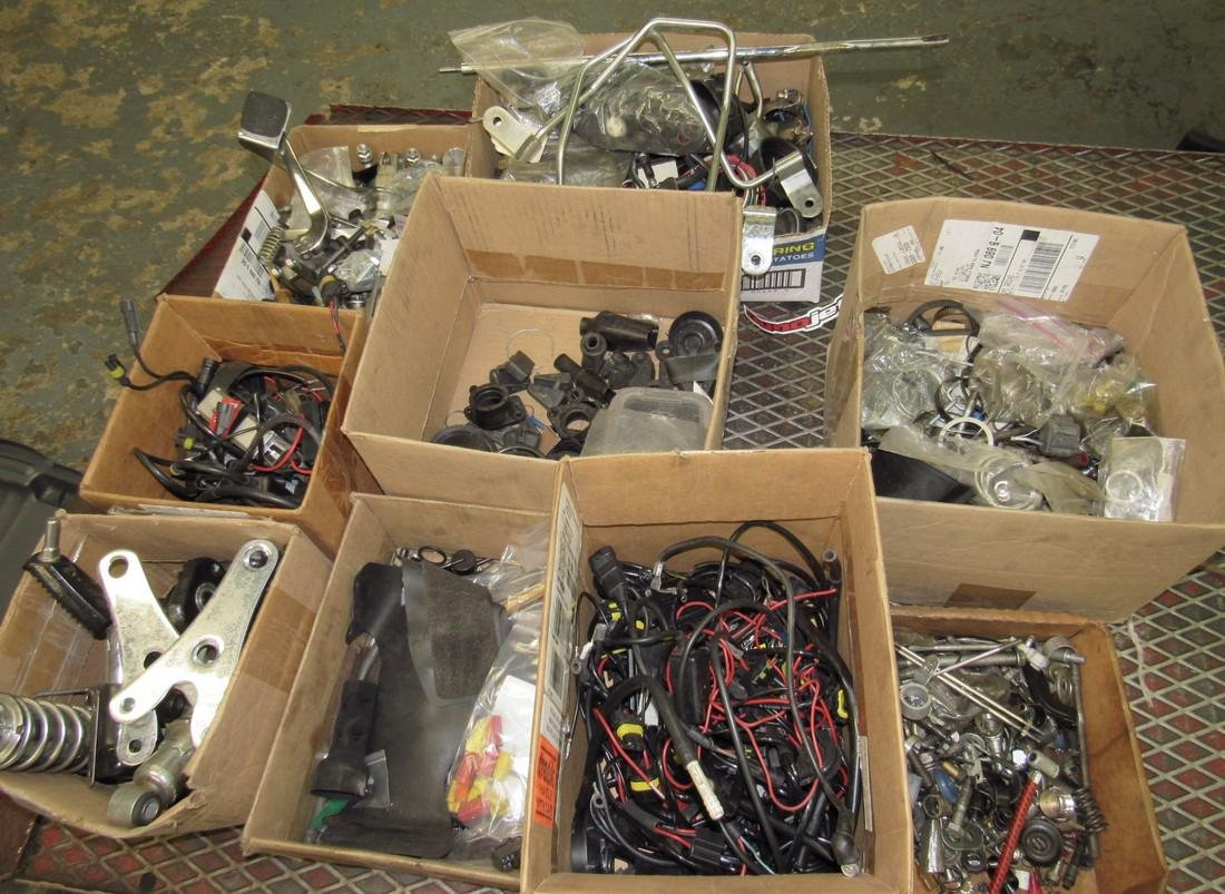 9 Boxes of Misc Used Motorcycle Parts