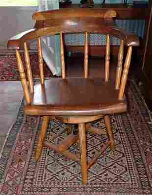 Early Swivel Arm Chair